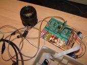 For testing, we used simple RS232 communication while the lens were powered indirectly via the firmware programmer. A bit messy but works reliably. Some other stuff, for instance, earphone cables are also there, just for military deception.